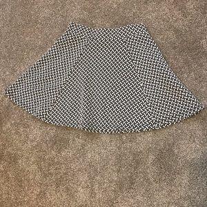 White and black patterned skirt